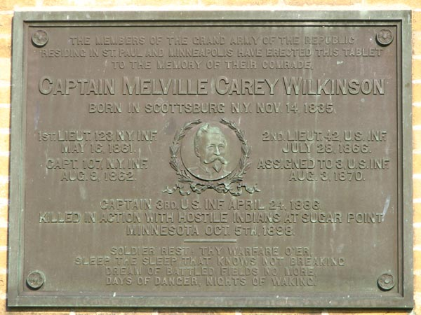 Plaque commemorating Captain Melville Carey Wilkinson who was killed at the battle of Sugar Point in 1898, placed on the front of the abandoned HQ building at Ft. Snelling.